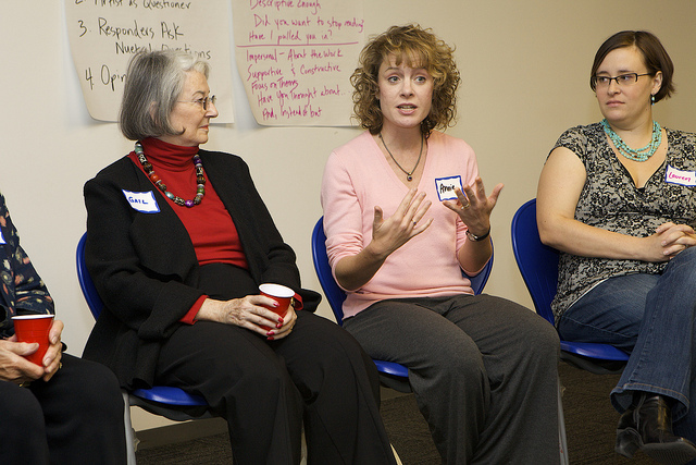 Roster Artists Annie Montgomery (middle) and Lauren Jost (right) lead a Lifetime Arts creative aging workshop at a library in New York City.